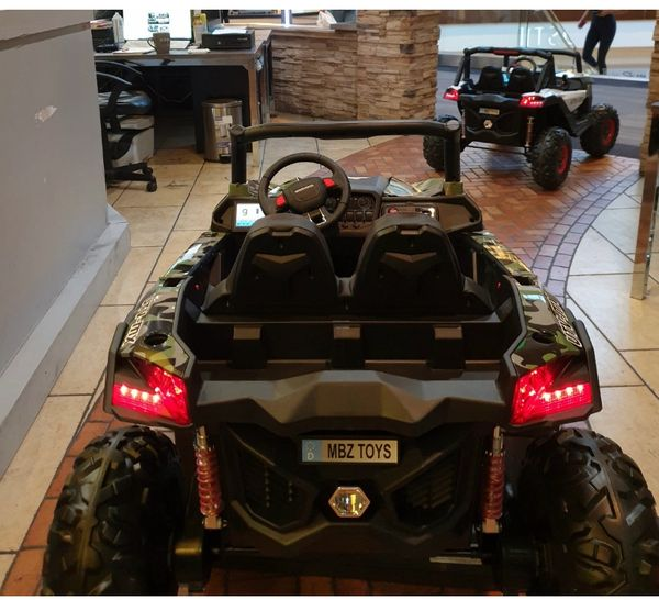 TOUCH TV , 24v , UTV MX 2000, ATV, RAZOR STYLE, PARENTAL REMOTE CONTROL OR PRESS ON PEDAL AND GO.. LEATHER SEAT , RUBBER TIRES , 4WD .