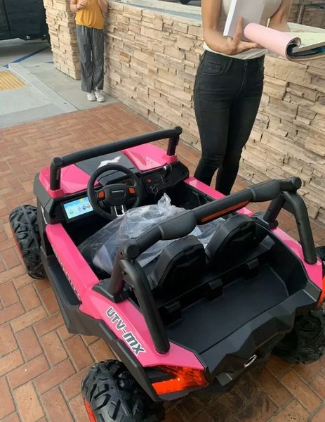 24V With 2x 12V batteries TOUCH TV , UTV MX 2000, ATV, PINK REMOTE CONTROL OR PRESS ON PEDAL AND GO.. LEATHER SEAT , RUBBER TIRES , 4WD .
