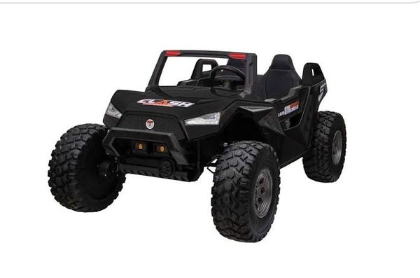TOUCH TV , 24V , GIANT BUGGY XL BLACK UTV AGES 2-10 RAZOR STYLE, PARE NTAL REMOTE CONTROL OR PRESS ON PEDAL AND GO.. LEATHER SEAT , RUBBER TIRES , 4WD .