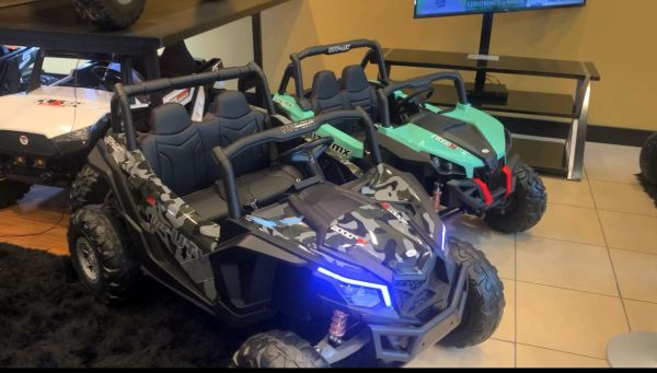$100 Layaway Deposit only Balance $495.00 At pick up Cash Giant UTV ride on with 24v 200 W Motors Touch TV Rubber Tires leather seat