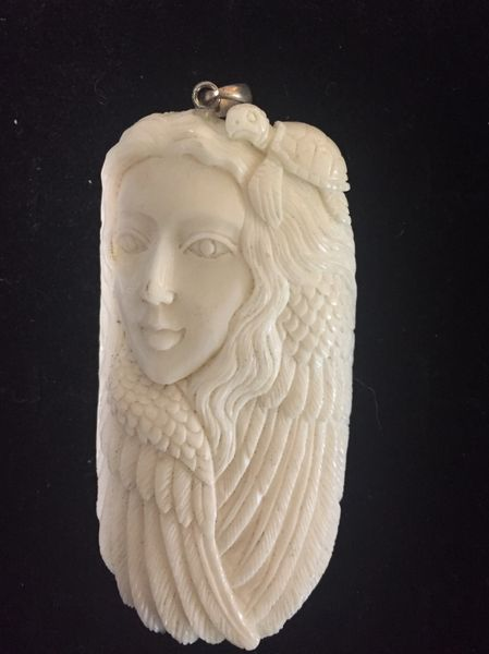 Girl With Turtle Carved Bone Pendant