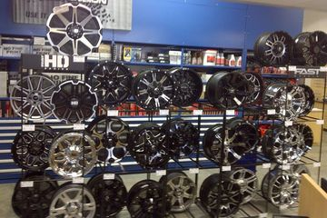 Alloy wheels displays contain car and truck wheels and mags