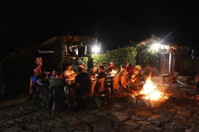 campfire in Bolivian jungle on south American guided motorcycle trip