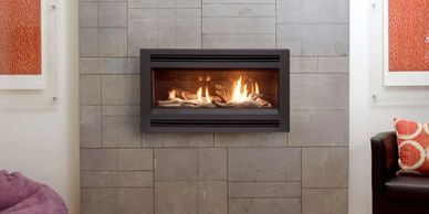 Pacific energy esprit gas log fire with louvre fascia ,on tiled wall.