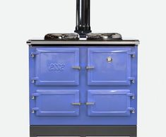 esse 990 series wood stove in light blue colour with black flue system.