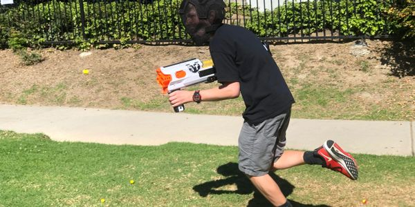 Best birthday ideas in Las Vegas. A boy is running and physically active through Nerf War Game.