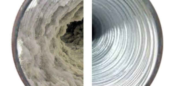 Dryer vent showing one half full of lint and the other half brushed and clean.