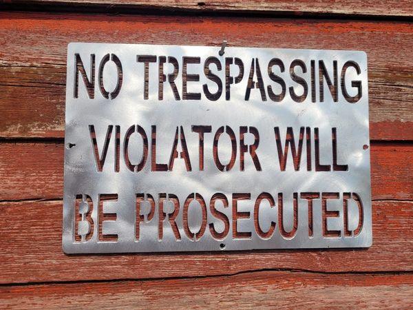 No Trespassing Violator will be prosecuted sign