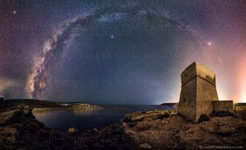 Milky way panorama arch from ghajn tuffieha tower. Milky way from Malta. Milkyway over riviera