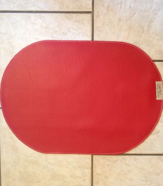 "Large Oval red pet bowl place mat approximately 23""L X 16"" W"