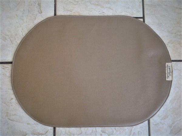 "Large Oval darker tan pet bowl place mat double sided approximately 23""L x 16""W"