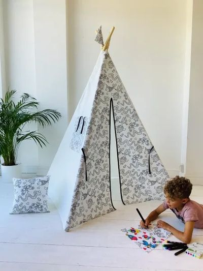 Boy playing in teepee