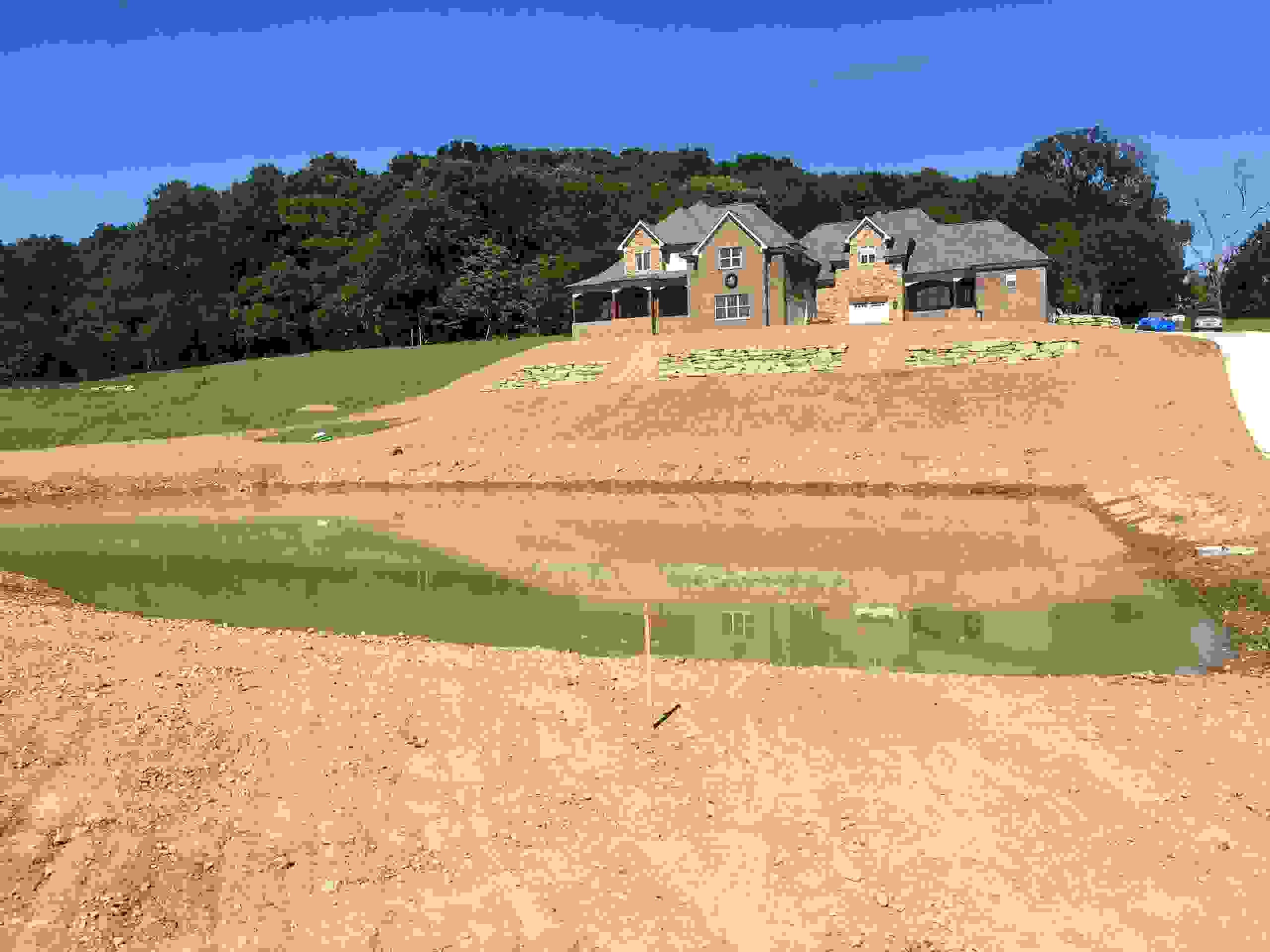 graded slope and around residential home and pond