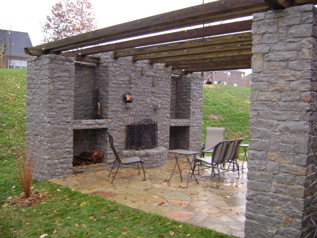 Outdoor fireplace construction with wooden beams and built-in storage