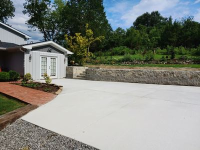 Driveway installation using concrete pads