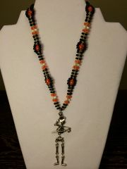 18 inch Necklace Black Orange with Skeleton Pendant