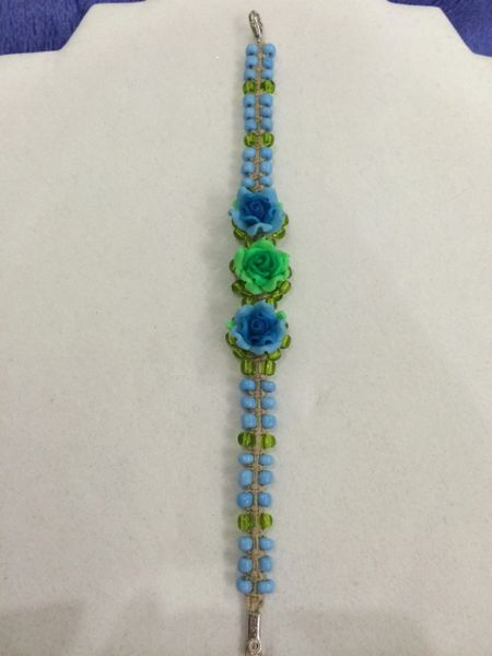 7 inch Bracelet Light Blue with Blue Flower Beads