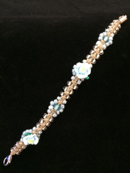 8 inch Bracelet Clear with Blue Flower Beads