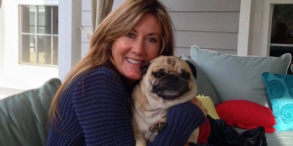 woman hugging pug