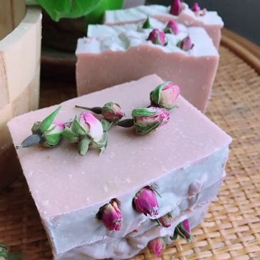 Pink soap with dried pink rosebuds