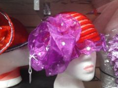 Red Spiral Hat with Ruffled Purple Flower and Trim