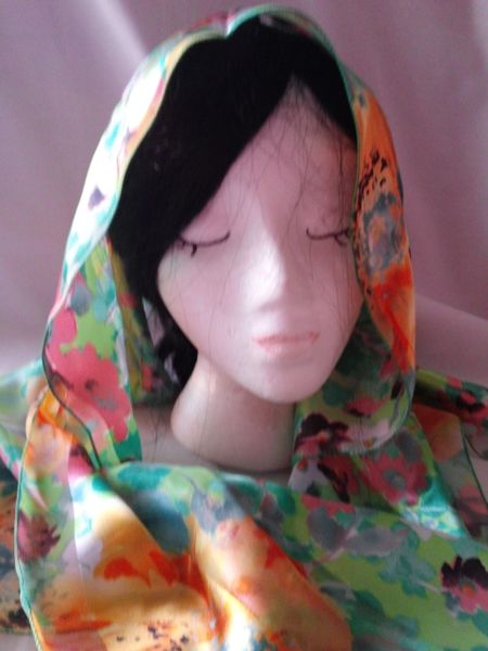 Green with orange print scarf