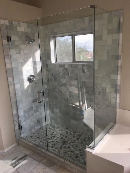 FRAMELESS SHOWER DOOR WITH NOTCHED INLINE PANEL AND 90 DEGREE RETURN