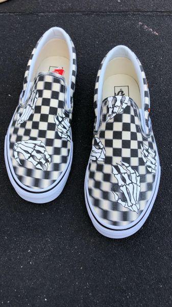 Skeleton Hands Checkerboard Slip-on Vans