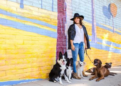 Zoe poses with community daycare pups during an outing in Venice.