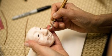 Make and Take Class student sculpting a face from polymer clay