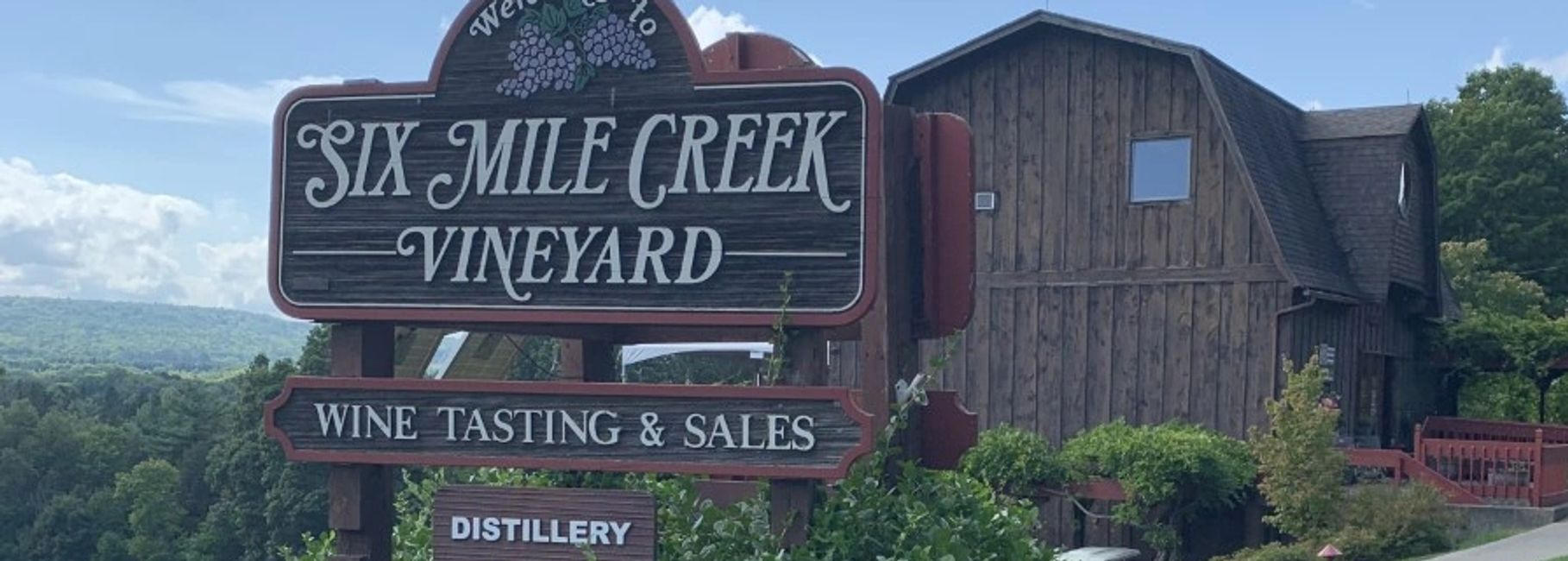 Six Mile Creek Vineyard sign and tasting room