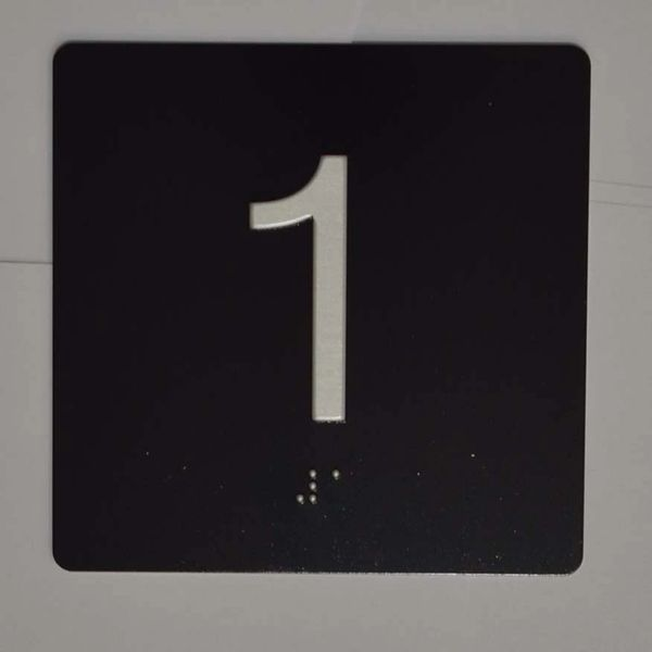 ELEVATOR JAMB- 1 BLACK (ALUMINUM SIGNS 4X4)- BRAILLE- The Sensation Line