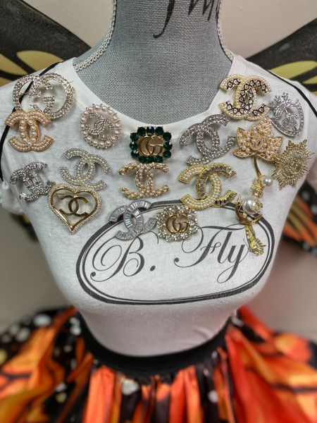 B. FLY BROOCHES