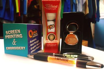 Promotional products such as sticky notes, golf balls, key chains, and pens.