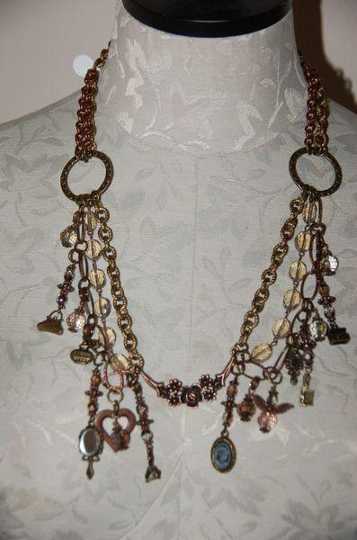 Victoria Brushed Gold Charm Design
