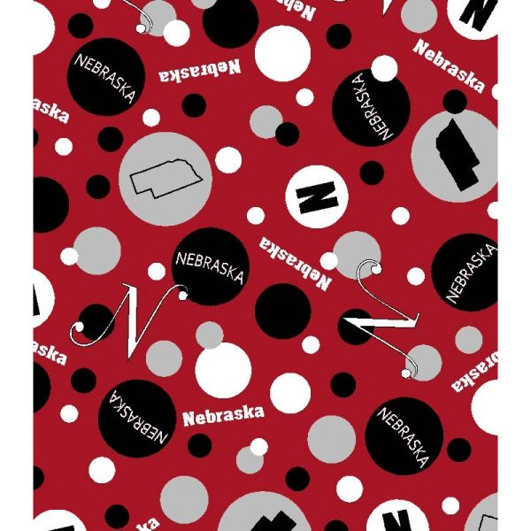 Nebraska Dots Fabric. Red dotted