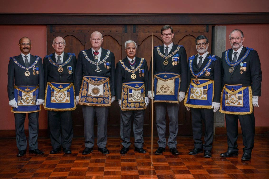 The RW DGM, The MW Pro Grand Master, and the Grand Secretary with Chain Officers of the District.