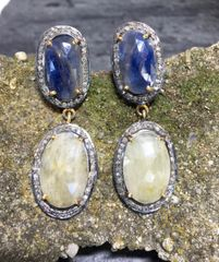 Rare Yellow and Blue Sapphire with Diamond Surround