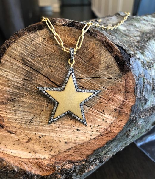 14kg over Sterling Sliver Star with Diamond surround on gold filled chain