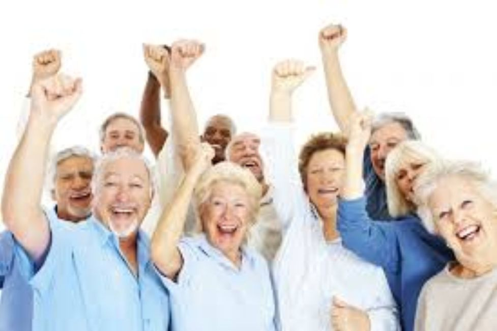 Happy senior citizens pumping their fists.