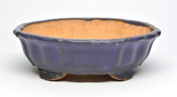 Hattori, blue glazed round with patina