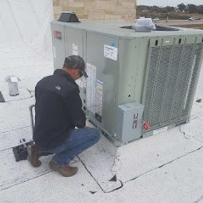 HVAC Technician performing a repair and maintenance.