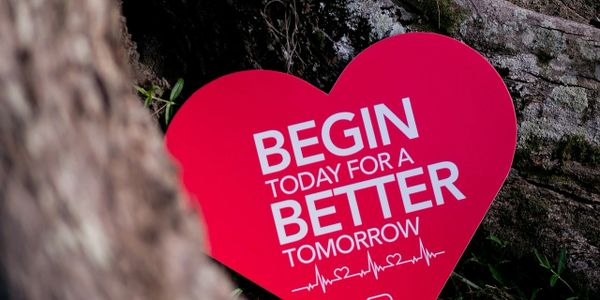 "Image with heart shape showing the message ""Begin today for a better tomorrow!"""