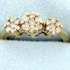 Vintage Champagne diamond cluster ring set in 10k yellow gold. Looks like a 3 stone ring but with 21 champagne diamonds. There is approximately a 1/2 carat total diamond weight. Size: 5 Weight: 2.3g