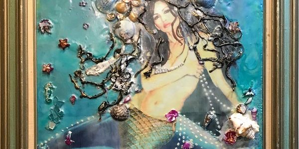 "The artist in self portrait as the pensive mermaid in, ""Remembering Atlantis"" an original encaustic work of art.  The inspiration came from a meditation in the crystal pyramid that lives in her gallery."