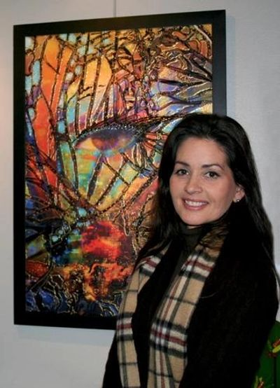 The artist Deprise with her award winning work, The Watcher.