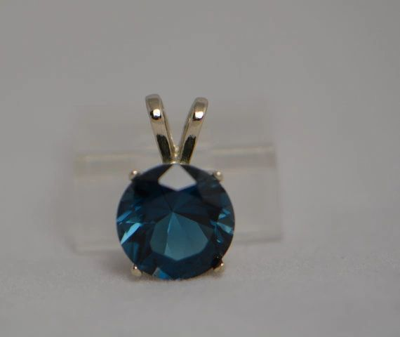 14kt White or Yellow Gold 9mm Round Genuine Topaz Pendant (London, Swiss or Sky Blue)