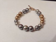 "7.5"" Metallic Imitation Pearl Bracelet Including Antique Imitation Gold Oval Toggle Clasp"