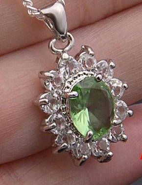 Sterling Silver Oval Bright Green Cubic Zirconia Accented Pendant (Chain Not Included)
