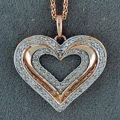 A 1/2ctw Diamond Heart Pendant on a Chain